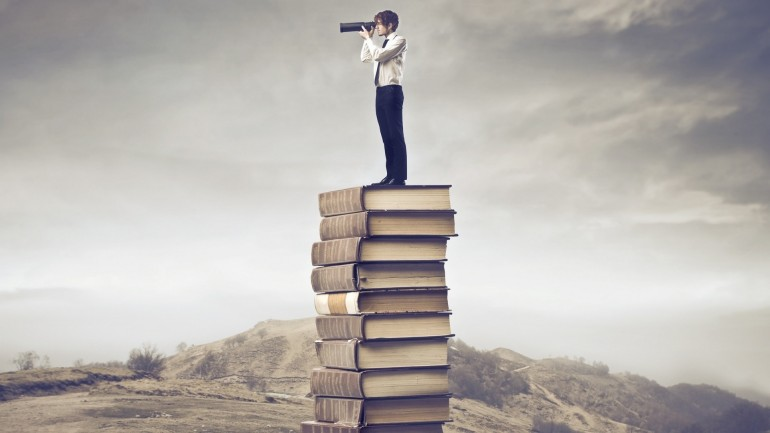 Creative_Wallpaper_A_man_with_a_telescope_on_a_pile_of_books_098133_